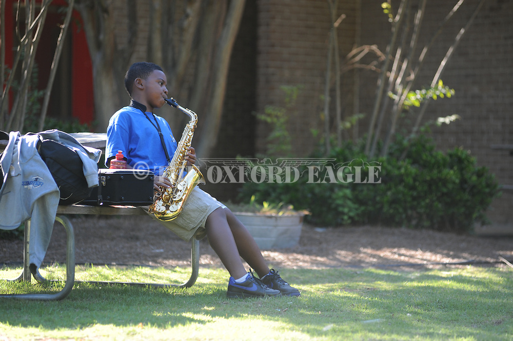 Kyle Gordon practices his saxophone while sitting outside Oxford Elementary in Oxford, Miss. on Monday, September 10, 2012. Gordon is in the band at Oxford Middle School.