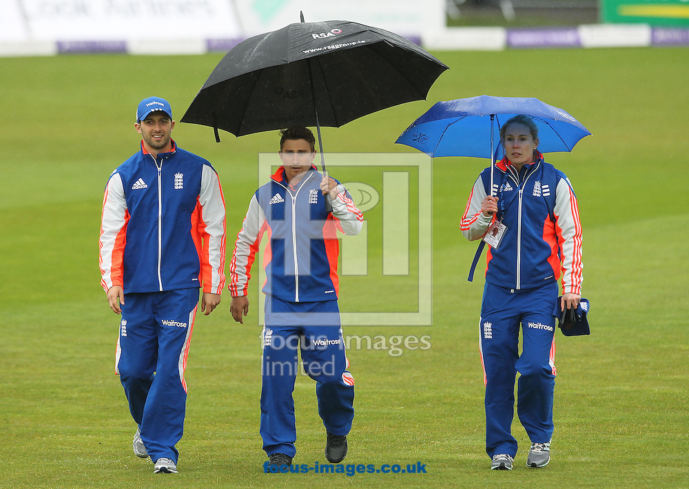 Mark Wood, James Taylor and Press Officer Beth Wylde make their way across the pitch after the the One Day International match at the Village, Malahide was abandoned due to bad weather<br /> Picture by Lorraine O'Sullivan/Focus Images Ltd +353 872341584<br /> 08/05/2015