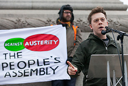 London, UK. 12th January, 2019. Journalist Owen Jones addresses hundreds of protesters taking part in a 'Britain is Broken: General Election Now' demonstration organised by the People's Assembly Against Austerity. Organisers argued that the overriding objective of working people in the UK should be to remove the Conservative Government from power through a general election regardless of their vote in the EU referendum.