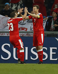 BASEL, Oct. 8, 2017  Switzerland's Stefan Lichtsteiner (R) celebrates with his teammate Sherdan Shaqiri after scoring during the FIFA World Cup 2018 Qualifiers Group B match between Switzerland and Hungary in Basel, Switzerland, Oct. 7, 2017. Switzerland won 5-2. (Credit Image: © Ruben Sprich/Xinhua via ZUMA Wire)