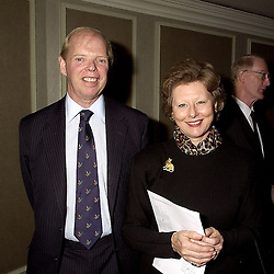 The EARL OF CAITHNESS and MRS DENISE FIENNES, at a luncheon in London on 18th October 2000.OHZ 66