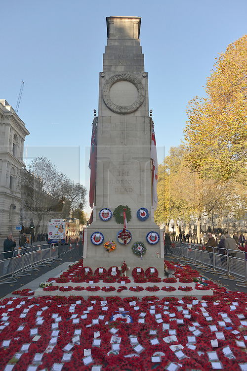 © Licensed to London News Pictures. 14/11/2012. Westminster, UK People look at poppies and wreaths today, 14th Nov 2012, left at the Cenotaph during remembrance Sunday.  . Photo credit : Stephen Simpson/LNP