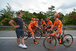 March 23, 2018 - Tanjung Malim, Malaysia - Members of CCC Sprandi Polkowice chat with their Sport Director, Piotr Wadecki, at the finish line of the sixth stage, the 108.5km from Tapah to Tanjung Malim, of the 2018 Le Tour de Langkawi. .On Friday, March 23, 2018, in Tanjung Malim, Malaysia. (Credit Image: © Artur Widak/NurPhoto via ZUMA Press)