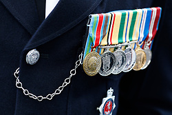 © Licensed to London News Pictures.10/04/2017.London, UK. Medals on the chest of an officers uniform as Police officers in No.1 Dress uniform line the streets around Southwark Cathedral in London where the funeral of PC Keith Palmer is due to take place this afternoon (Mon). PC Palmer was murdered just inside the gate by Westminster attacker Khalid Masood - an attack in which he also killed four people on Westminster Bridge.Photo credit: Tom Nicholson/LNP