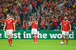 LILLE, FRANCE - Friday, July 1, 2016: Wales' captain Ashley Williams looks dejected as Belgium score the opening goal during the UEFA Euro 2016 Championship Quarter-Final match at the Stade Pierre Mauroy. (Pic by David Rawcliffe/Propaganda)