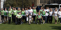 © Licensed to London News Pictures.  29/03/2012. LONDON, UK. Shadow Chancellor Ed Balls (pictured centre) poses in his running gear (including compression tights) with  fellow Virgin London Marathon runners from his two chosen charities, Whizz-Kidz and Action for Stammering Children. Photo credit:  Cliff Hide/LNP