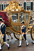 "Prinsjesdag - Koninklijke familie in de Gouden Koets<br /> <br /> Budget Day - Royal family in the Golden Coach<br /> <br /> Op de foto / On the photo:   Gouden Koets met de "" slavenillustratie "" // <br /> Golden Coach with the ""slaves illustration"""