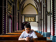 26 NOVEMBER 2017 - YANGON, MYANMAR: A man prays in St. Mary's Cathedral in Yangon after Sunday mass. Pope Francis will say a special mass in the cathedral this week and is staying at the Bishop's Residence, adjacent the cathedral, during his visit. The Pope will visit Yangon November 27 - 30. He will have private meetings  with government officials, military leaders and Buddhist clergy. He will also participate in two masses, a public mass in a sports complex on November 29 and a mass for Myanmar youth in St. Mary's Cathedral on November 30.    PHOTO BY JACK KURTZ