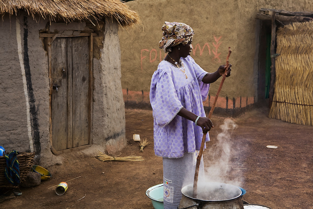 Hawa Diakite cooks millet for lunch. Hawa Diakite and her co wife Djene-Sira Diakite have lost many children to diarrhea and other illnesses. interviewed by Viv. Sogola, Mali.