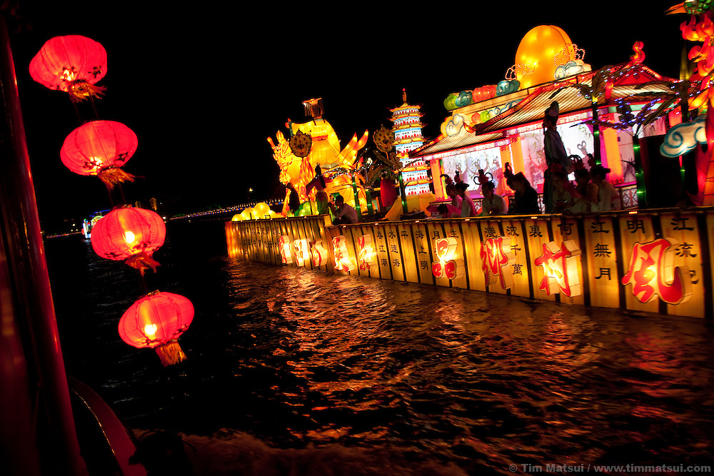 Decorated boats ply the 2500 year-old Grand Canal in Yangzhou, China, for the Harvest Festival. Yangzhou is a suburb city of Shanghai and major producer of photovoltaic cells for solar power.