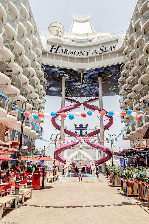 Royal Caribbean, Harmony of the Seas, Seas is the Ultimate Abyss, the tallest slide on the high seas, which will intimidate the bravest of guests and challenge them to prove their courage. Towering more than 150 feet above sea level, overlooking the AquaTheater at the aft of the ship, Boardwalk