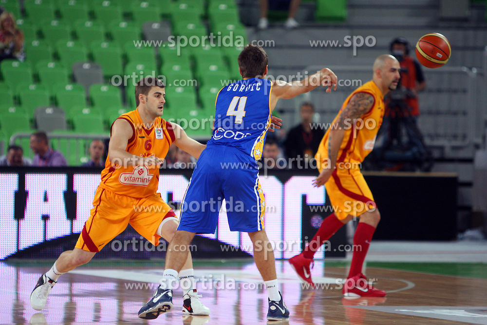 Nemanja Gordic of BiH and Darko Sokolov of Macedonia at friendly match between Macedonia and BIH for Adecco Cup 2011 as part of exhibition games before European Championship Lithuania on August xx, 2011, in SRC Stozice, Ljubljana, Slovenia. (Photo by Urban Urbanc / Sportida)