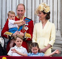 File photo dated 08/06/19 of the Duke and Duchess of Cambridge with their children, Prince Louis, Prince George and Princess Charlotte, on the balcony of Buckingham Place as they watch the flypast following Trooping the Colour ceremony. Prince Louis of Cambridge, who is celebrating his second birthday on Thursday, was born on patriotic St George???s Day in 2018.