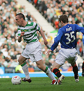 Scott Brown turns away from Steven Davis during the League Cup final between Rangers and Celtic at Hampden Park -<br /> David Young Universal News And Sport