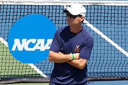 May 23, 2011; Stanford, CA, USA;  Virginia Cavaliers head coach Brian Bolland watches his team during the semifinals of the men's team 2011 NCAA Tennis Championships against the Ohio State Buckeyes at the Taube Family Tennis Center.