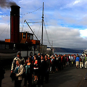 Passengers board  the TSS Earnslaw, the 100 year old vintage coal fired passenger steam ship which sails on Lake Wakatipu, Queenstown, New Zealand. The popular tourist attraction is celebrating it's centenary year with celebrations planned for October 2012.  Queenstown, Central Otago, New Zealand. 29th February 2012. Photo Tim Clayton