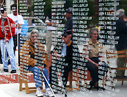 The faces of those who came home from the Korean War are reflected in the black granite of Korean War Memorial alongside the names of those who died.