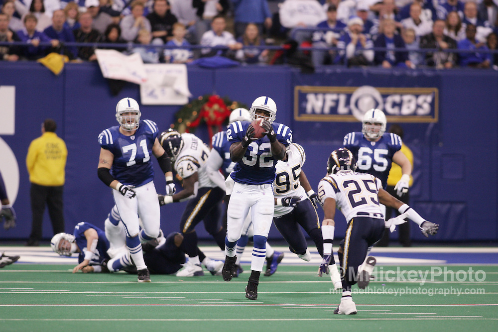 As Peyton Manning goes down for a near-sack Edgerrin James pulls in a desperation pass in the fourth quarter of action against the Chargers in the RCA Dome. The Colts defeated the Chargers 34-31.