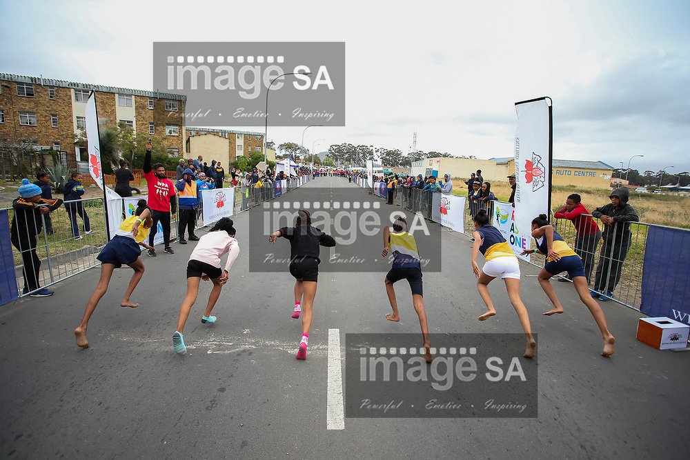 CAPE TOWN, SOUTH AFRICA - Wednesday 25 October 2017, members of the public, school children and residents of Arion Street, Atlantis, participate in the Western Province Athletics (WPA) Street Athletics programme.  Children of all ages and adults, get to run various distances from 50m to 400m in a closed-off street within a residential area. These events are organised by the WPA Development office and sponsored by the Old Mutual Two Oceans Marathon (OMTOM).<br /> Photo by Roger Sedres/ImageSA