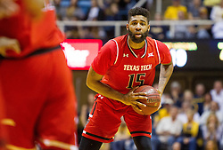 Feb 18, 2017; Morgantown, WV, USA; Texas Tech Red Raiders forward Aaron Ross (15) looks to pass during the first half against the West Virginia Mountaineers at WVU Coliseum. Mandatory Credit: Ben Queen-USA TODAY Sports
