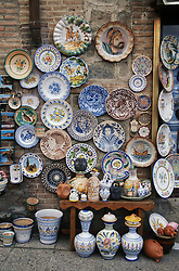 Pottery shop in Toledo with display of decorated plates and jars,