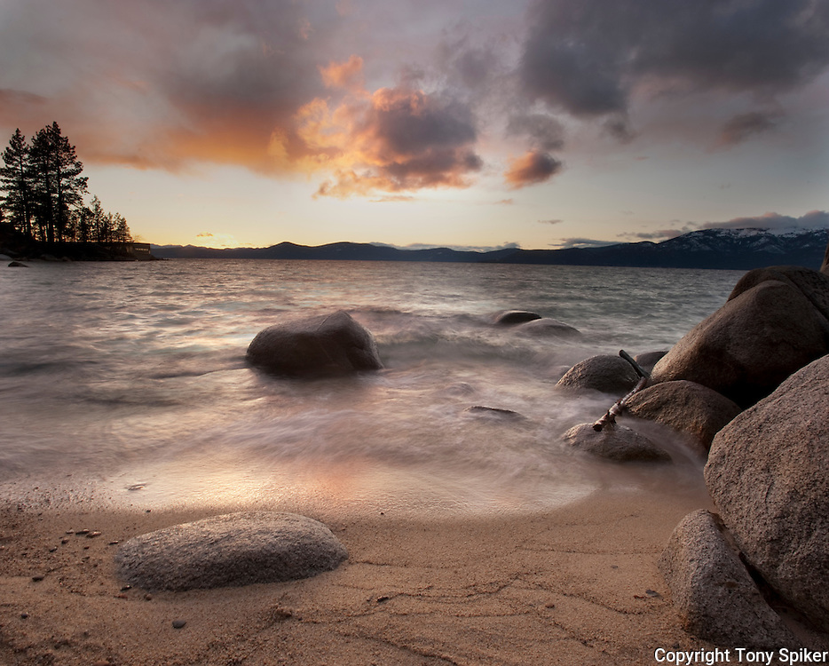 """Thunderbird Beach Sunset 4"" - The sun sets as a storm clears over the beach by Thunderbird Lodge, on the Eastern shore of Lake Tahoe."