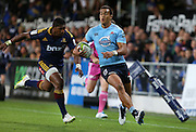 Waratahs Peter Betham makes a break against the Highlanders in the Super 15 rugby match, Forsyth Barr Stadium, Dunedin, New Zealand, Saturday, March 14, 2015. Credit: SNPA/Dianne Manson