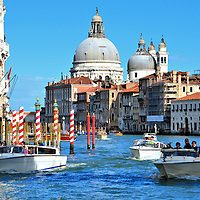 Italian Boat Rush Hour on Grand Canal in Venice, Italy<br /> The waterways in and around Venice are full of boats including ferries, water taxis, steamers, cargo, sanitation, water buses (called vaporetti), gondolas and speed boats. It is hard to imagine how they all navigate the S-shaped, Grand Canal so effortlessly. In addition, there is usually a cruise ship or two docked nearby.
