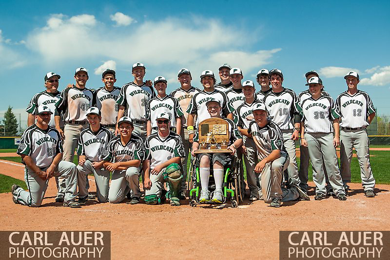 May 17th 2013: Fleming Wildcats senior Jeremy Richhard-Kind (7) holds the Colorado State Championship trophy during the team photo after his team defeated the Holly Wildcats 5-3 in the CHSAA 1A Baseball final at All Star Park in Lakewood, Colorado