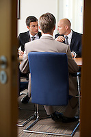 Businessmen in meeting at board room
