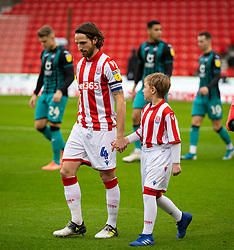 STOKE-ON-TRENT, ENGLAND - Saturday, January 25, 2020: Stoke City's captain Joe Allen leads his side out with a mascot before the Football League Championship match between Stoke City FC and Swansea City FC at the Britannia Stadium. (Pic by David Rawcliffe/Propaganda)