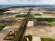 Nederland, Noord-Holland, Gemeente Wieringermeer, 16-04-2012. Wieringermeerpolder, overzicht langs zichtas van de Hooge Kwelvaart (een van de hoofdvaarten van de polder). Rechts windmolens langs de Robbenoordweg...Wieringmeer polder,  newly created land 1927, part of the Zuiderzee Works..luchtfoto (toeslag), aerial photo (additional fee required);.copyright foto/photo Siebe Swart