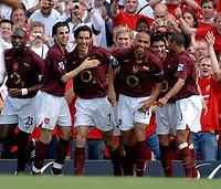 Photo: Daniel Hambury.<br />Arsenal v Wigan Athletic. The Barclays Premiership. 07/05/2006.<br />Arsenal's Robert Pires celebrates with team mates. 1-0.
