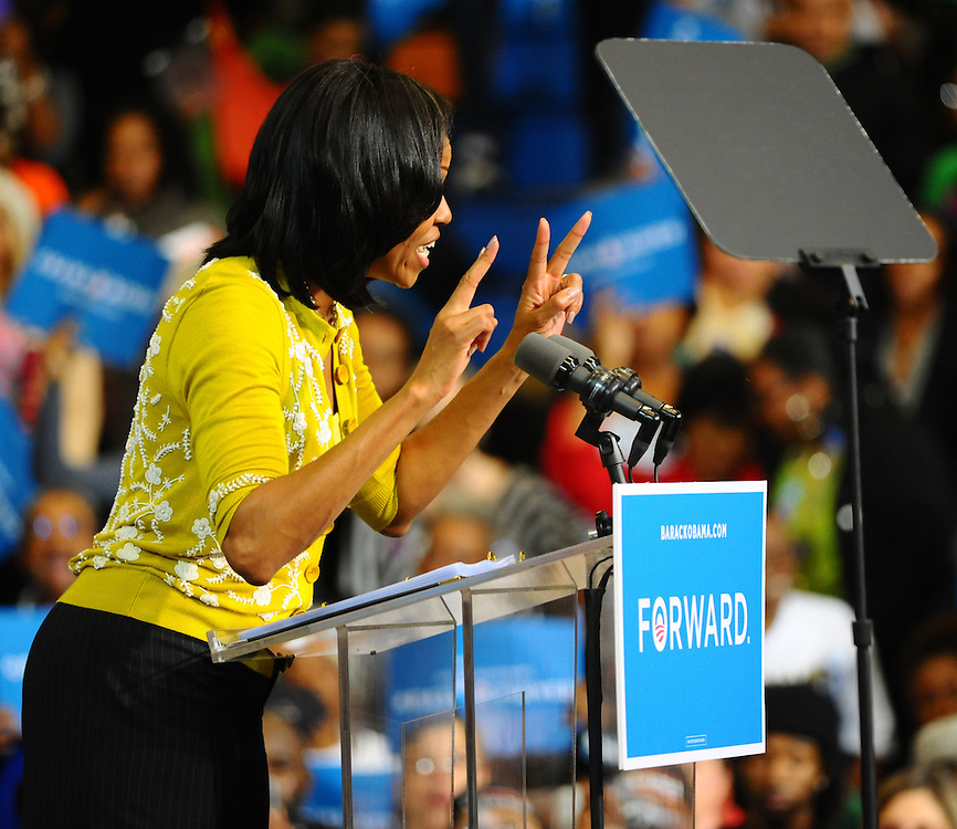 LAURA FONG |  First Lady Michelle Obama greets a crowd of 2,000 at Cuyahoga Community College in Cleveland. Obama reminded supporters that with only 22 days left in the election there is still much work to do to win the state of Ohio.