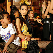 Pre-teens and professional models wait backstage before hitting the catwalk at a fashion show in Hanoi, Vietnam. With government-instituted market reforms and a rapidly growing economy, young urban Vietnamese now have more disposable income to spend on mobile phones, slick motorbikes and up-to-date fashions.