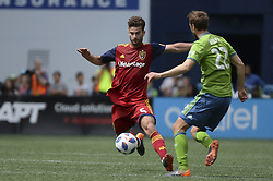 May 26, 2018 - Seattle, Washington, U.S - MLS Soccer 2018: RSL's KYLE BECKERMAN (5) gets pressured by Seattle's MAGNUS WOLFF EIKREM (22) as Real Salt Lake visits the Seattle Sounders in a MLS match at Century Link Field in Seattle, WA. (Credit Image: © Jeff Halstead via ZUMA Wire)