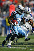 NASHVILLE, TN - DECEMBER 3:  Running back Travis Henry #20 of the Tennessee Titans runs the ball for some of his 93 yards on 20 carries against the Indianapolis Colts at LP Field on December 3, 2006 in Nashville, Tennessee. The Titans defeated the Colts 20-17. ©Paul Anthony Spinelli *** Local Caption *** Travis Henry