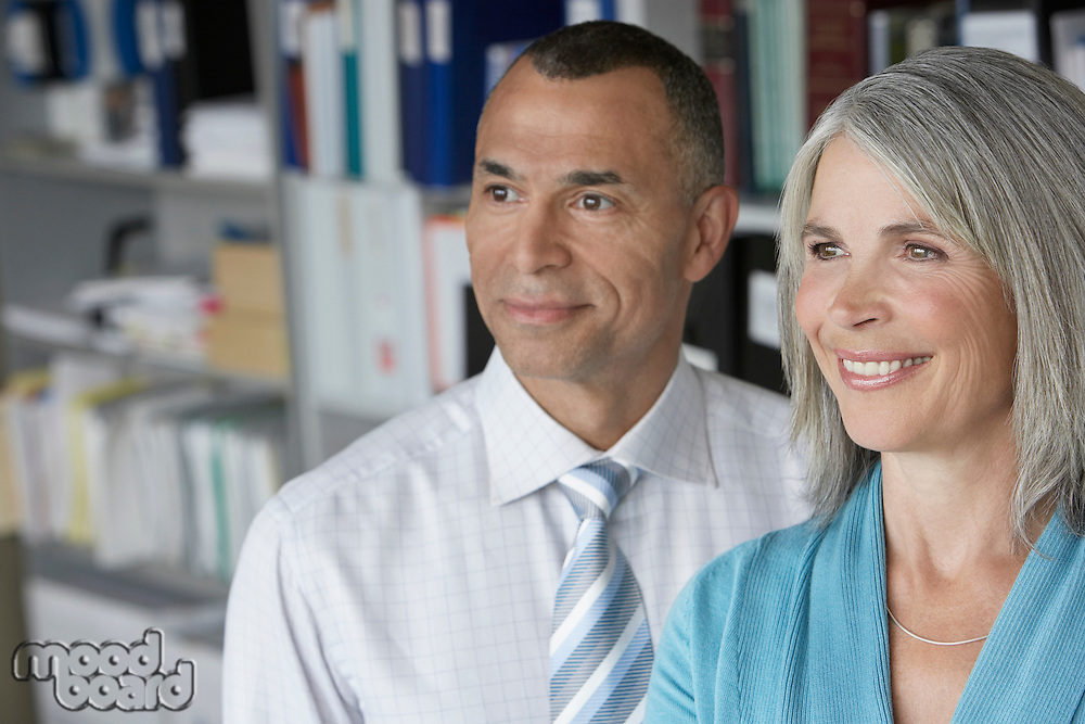 Business couple standing in office portrait elevated view
