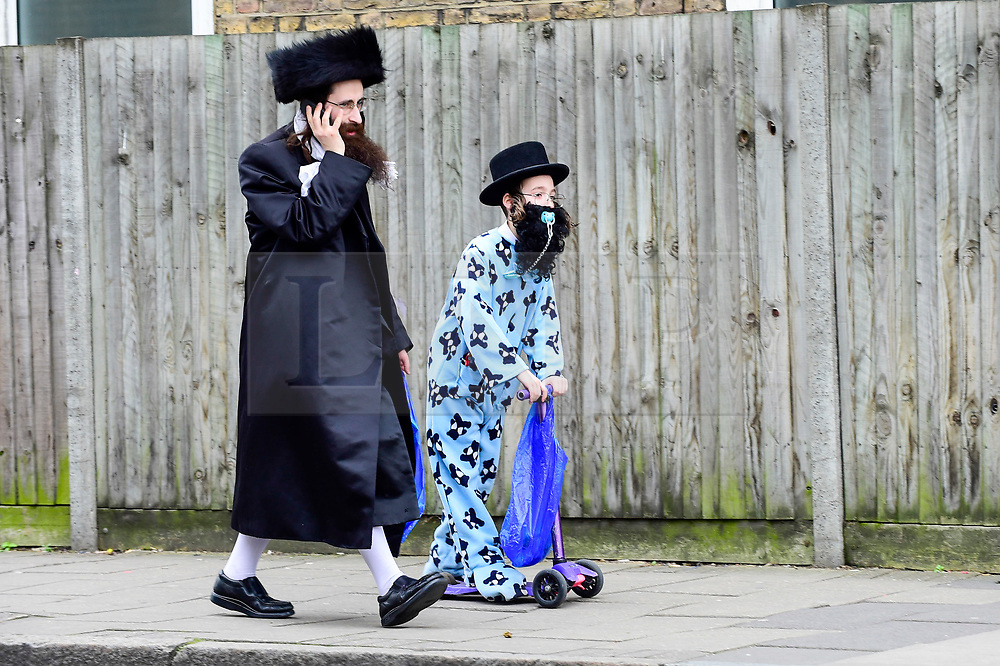 © Licensed to London News Pictures. 21/03/2019. LONDON, UK.  A boy in Stamford Hill, north London, dressed in a colourful costume celebrates the Jewish festival of Purim.  The festival involves the reading of the Book of Esther, describing the defeat of Haman, the Persian king's adviser, who plotted to massacre the Jewish people 2,500 years ago, an event that was prevented by Esther's courage.  Photo credit: Stephen Chung/LNP