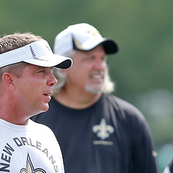 Aug 3, 2013; Metairie, LA, USA; New Orleans Saints head coach Sean Payton and defensive coordinator Rob Ryan following a scrimmage at the team training facility. Mandatory Credit: Derick E. Hingle-USA TODAY Sports