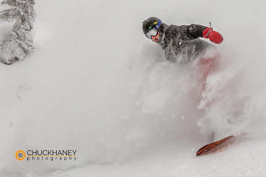 Snowboarding in powder at Whitefish Mountain Resort, Montana, USA MR