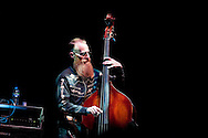 Critically acclaimed jazz trio, Neil Cowley Trio perform music from their new album, Touch and Flee, live at the Barbican Theatre, London, UK (3 October 2014). Pictured here, Rex Horan on bass. ©Rudolf Abraham