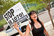 15 JULY 2010 - PHOENIX, AZ: Marylou Cabral (CQ) from Mesa, demonstrates against SB 1070 in front of the courthouse. People for and against SB 1070 picketed the front of the Sandra Day O'Connor US Courthouse (CQ) in Phoenix Thursday morning during the first hearing against SB 1070.    PHOTO BY JACK KURTZ