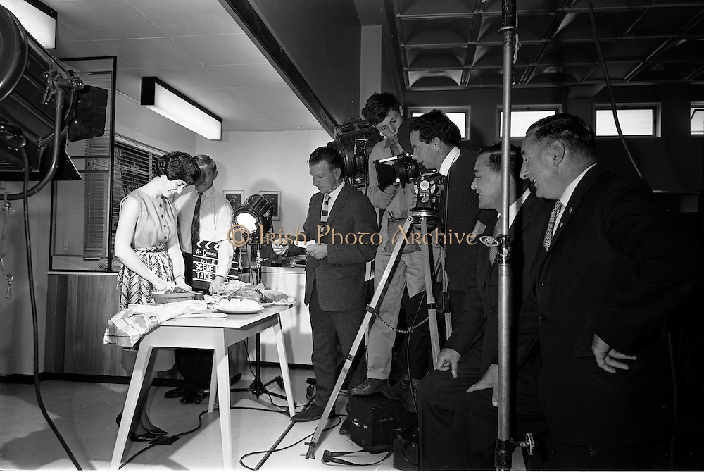 31/07/1962<br /> 07/31/1962<br /> 31 July 1962<br /> G.E.C. Film for TV at ESB showrooms, Fleet Street, Dublin. Image shows Vincent Corcoran filming a G.E.C. TV advertising film for Kennys Advertising Agency. The advertising seems to have been for G.E.C. Treasure cookers.