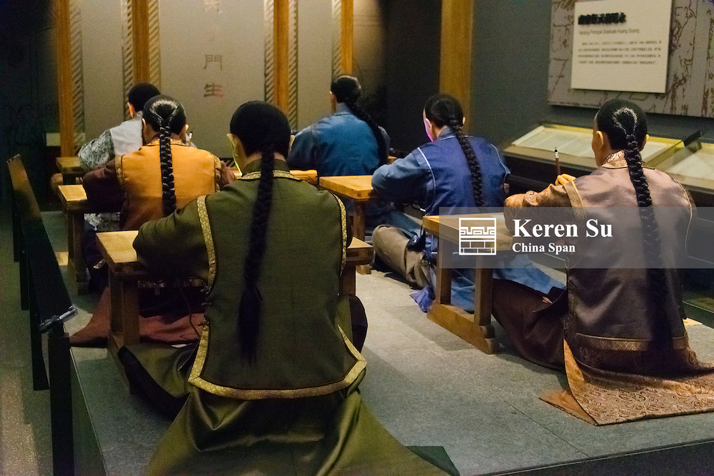Display showing students taking the Imperal Examination druing the Qing Dynasty in Museum of Chinese Imperial Examination, Nanjing, Jiangsu Province, China