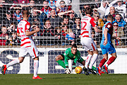 Doncaster Rovers goalkeeper Marko Marosi (13) saves during the EFL Sky Bet League 1 match between Scunthorpe United and Doncaster Rovers at Glanford Park, Scunthorpe, England on 23 February 2019.