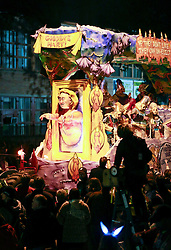 13 Feb 2015. New Orleans, Louisiana.<br /> Mardi Gras. Krewe D'Etat makes its way along Magazine Street.<br /> Photo; Charlie Varley/varleypix.com