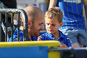 Young AFC Wimbledon fan sharing sweets with dad during the EFL Sky Bet League 1 match between AFC Wimbledon and Shrewsbury Town at the Cherry Red Records Stadium, Kingston, England on 14 September 2019.