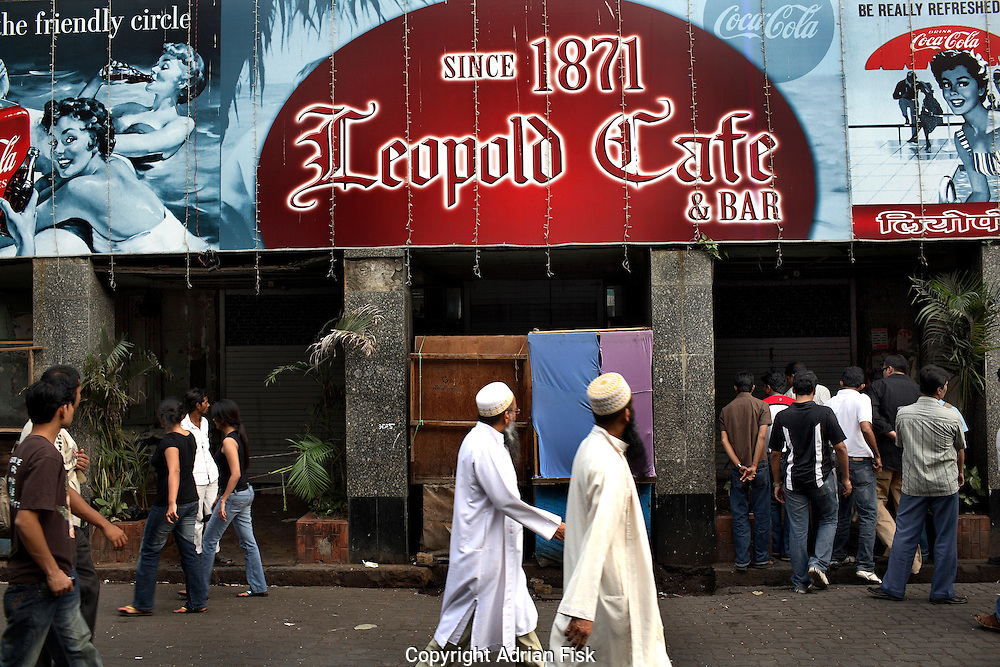Local people come to look at the famous Leopolds cafe where seven people died from a grenade and gun shots.. The streets here are normally full of foreigners but at this time none could be seen.