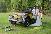 bride and groom with wedding car yellow 1927 Dodge Roadster by Tallmadge wedding photographer, Akron wedding photographer Mara Robinson Photography